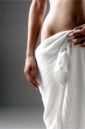 female nude hip - Naked woman, hand on towel on her sex, close up (studio) Stock Photo - Premium Royalty-Free, Code: 6108-05855886