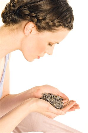 smelly - Portrait of a young woman holding grains of lavander Stock Photo - Premium Royalty-Free, Code: 6108-05855937
