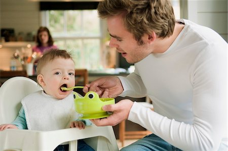 Father feeding her baby Stock Photo - Premium Royalty-Free, Code: 6108-05856027