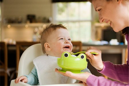 Mother feeding her baby Stock Photo - Premium Royalty-Free, Code: 6108-05856026