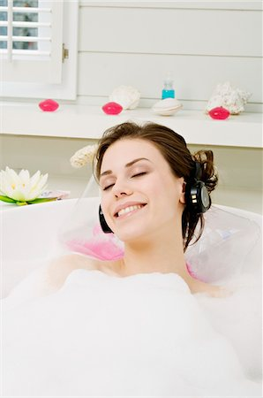 Young woman having a bath, wearing headphones Stock Photo - Premium Royalty-Free, Code: 6108-05856201
