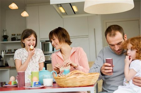 Couple and 2 little girls at breakfast table Stock Photo - Premium Royalty-Free, Code: 6108-05856653