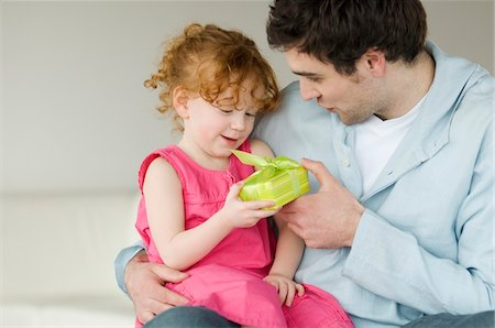 Man giving present to little girl Stock Photo - Premium Royalty-Free, Code: 6108-05856692