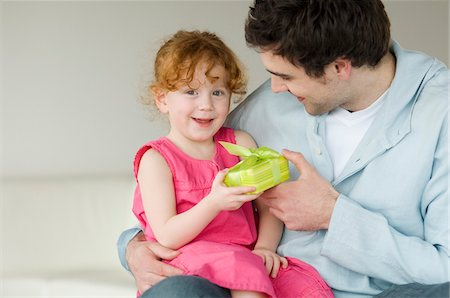 Man giving present to little girl Stock Photo - Premium Royalty-Free, Code: 6108-05856609
