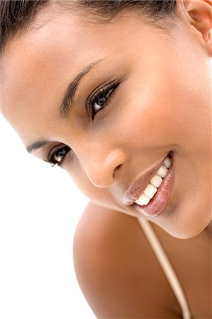 Portrait of a young smiling woman Stock Photo - Premium Royalty-Free, Code: 6108-05857402