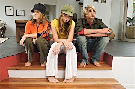 2 teenage girls and 1 teenage boy looking sullen Stock Photo - Premium Royalty-Free, Code: 6108-05857747