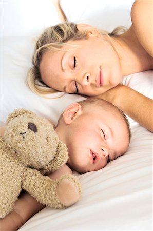 sleepy old woman - Portrait  mother and her baby sleeping, indoors Stock Photo - Premium Royalty-Free, Code: 6108-05857942