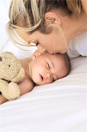 sleepy old woman - Portrait of mother kissing her baby sleeping, indoors Stock Photo - Premium Royalty-Free, Code: 6108-05857934