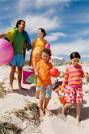 property release - Parents and two children walking on the beach, outdoors Stock Photo - Premium Royalty-Free, Code: 6108-05858094