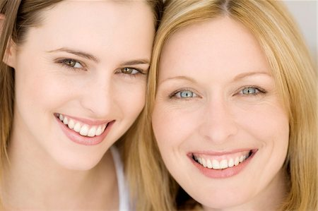 Portrait of two women smiling for the camera, indoors Stock Photo - Premium Royalty-Free, Code: 6108-05858147