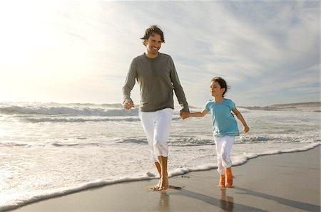 family shoes - Father and daughter walking on the beach, outdoors Stock Photo - Premium Royalty-Free, Code: 6108-05858135