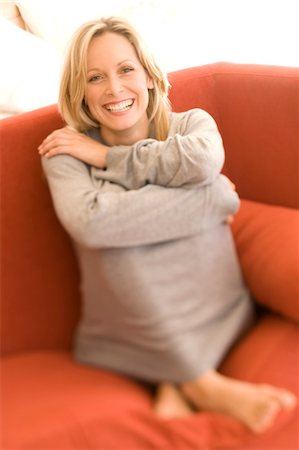 sweater - Young woman smiling for the camera Stock Photo - Premium Royalty-Free, Code: 6108-05858443