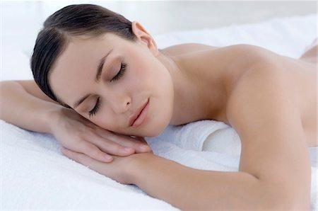 sleeping nude - Young woman sleeping in bed, indoors Stock Photo - Premium Royalty-Free, Code: 6108-05858453