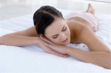 sleeping nude - Young woman sleeping in bed, indoors Stock Photo - Premium Royalty-Free, Code: 6108-05858481