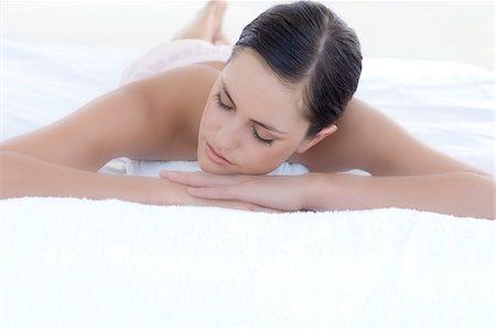 sleeping nude - Young woman sleeping in bed, indoors Stock Photo - Premium Royalty-Free, Code: 6108-05858492