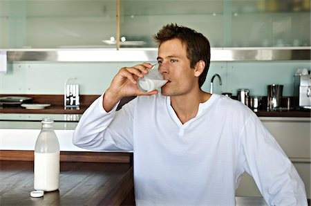 drink (non-alcohol) - Young man drinking milk in kitchen Stock Photo - Premium Royalty-Free, Code: 6108-05859063