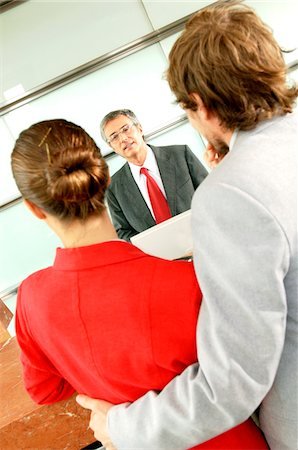 Business people in office, rear view Stock Photo - Premium Royalty-Free, Code: 6108-05859439