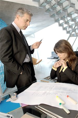 dominant woman - Businessman discussing with colleague in office Stock Photo - Premium Royalty-Free, Code: 6108-05859628