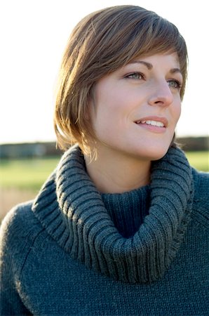 sweater - Close-up of a young woman smiling Stock Photo - Premium Royalty-Free, Code: 6108-05859747