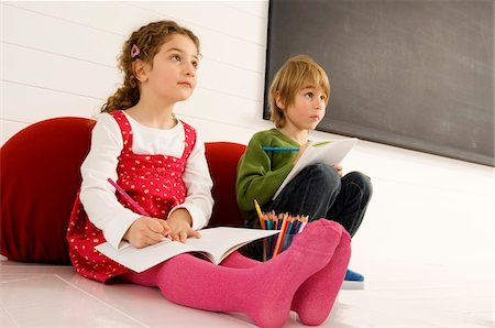 pantyhose kid - Boy and a girl drawing on notepads Stock Photo - Premium Royalty-Free, Code: 6108-05860272