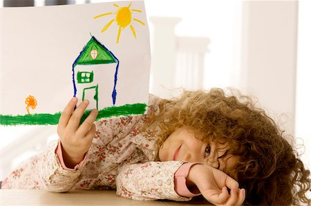 draw - Girl showing a drawing and smiling Stock Photo - Premium Royalty-Free, Code: 6108-05860287