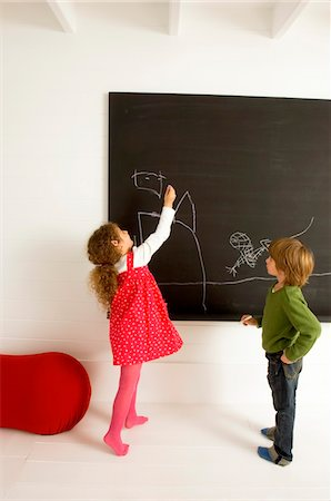 pantyhose kid - Girl drawing on a blackboard and her brother watching her Stock Photo - Premium Royalty-Free, Code: 6108-05860294
