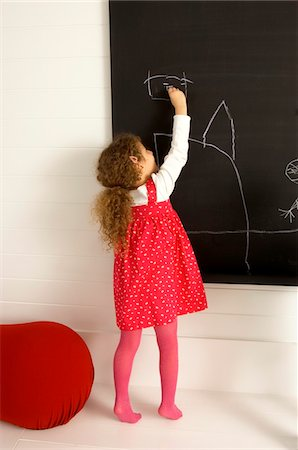 pantyhose kid - Girl drawing on a blackboard Stock Photo - Premium Royalty-Free, Code: 6108-05860226