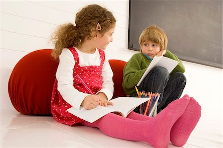 pantyhose kid - Boy and a girl drawing on notepads Stock Photo - Premium Royalty-Free, Code: 6108-05860236