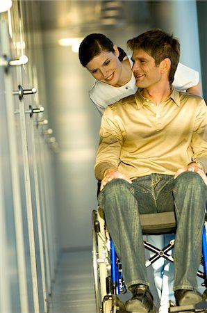 patient walking hospital halls - Female doctor pushing a male patient sitting in a wheelchair Stock Photo - Premium Royalty-Free, Code: 6108-05860445