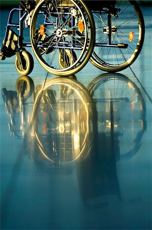 Wheelchair in a corridor of a hospital Stock Photo - Premium Royalty-Free, Code: 6108-05860436