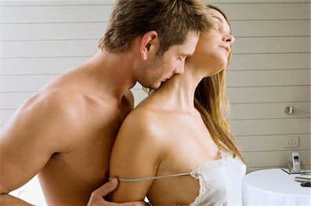 Mid adult man and a young woman romancing Stock Photo - Premium Royalty-Free, Code: 6108-05860719