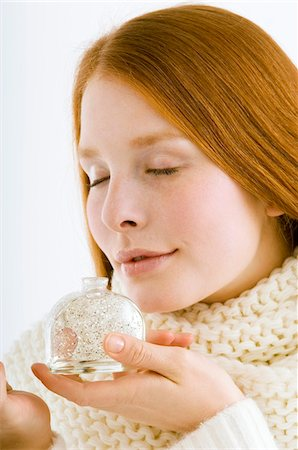 smelly - Close-up of a young woman smelling perfume from a bottle Stock Photo - Premium Royalty-Free, Code: 6108-05861003