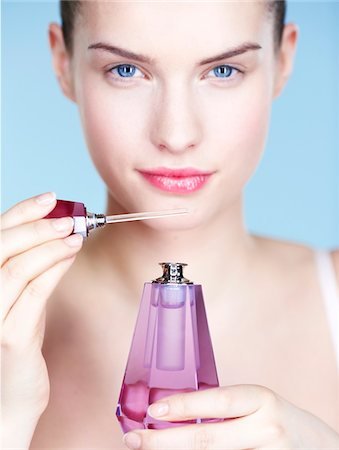 smelly - Young woman smelling perfume Stock Photo - Premium Royalty-Free, Code: 6108-05861349
