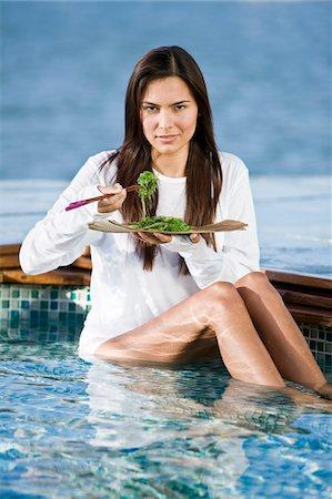 Woman eating seaweed with chopsticks Stock Photo - Premium Royalty-Free, Code: 6108-05861651