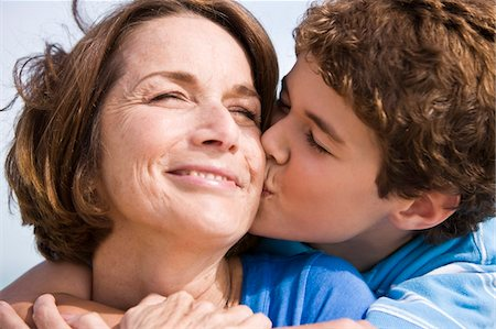 people kissing little boys - Boy kissing his grandmother Stock Photo - Premium Royalty-Free, Code: 6108-05862612