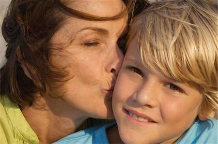 people kissing little boys - Woman kissing her grandson Stock Photo - Premium Royalty-Free, Code: 6108-05862633