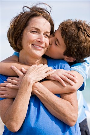 people kissing little boys - Boy kissing his grandmother Stock Photo - Premium Royalty-Free, Code: 6108-05862631