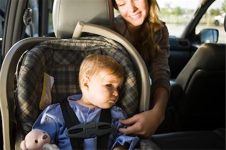 Woman with her son in a car Stock Photo - Premium Royalty-Free, Code: 6108-05862770