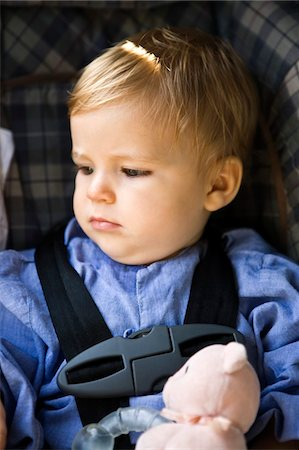Baby boy sitting in a baby seat Stock Photo - Premium Royalty-Free, Code: 6108-05862787