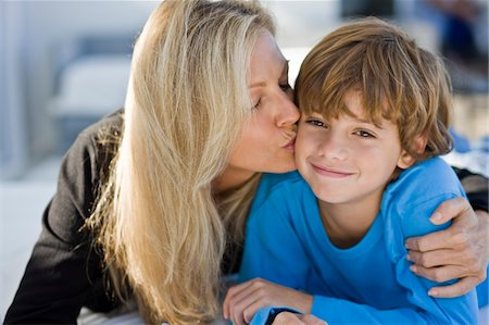 people kissing little boys - Woman kissing her son Stock Photo - Premium Royalty-Free, Code: 6108-05862731