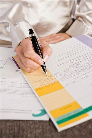 form - Mid section view of a woman filling out an application form Stock Photo - Premium Royalty-Free, Code: 6108-05862873