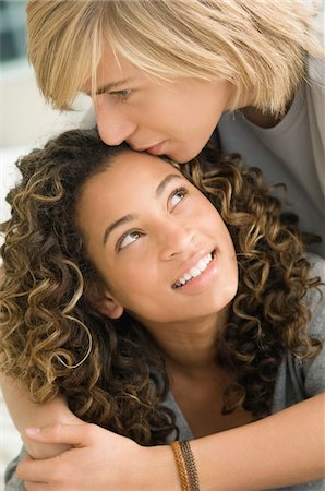 Teenage boy kissing on the forehead of a girl Stock Photo - Premium Royalty-Free, Code: 6108-05862890
