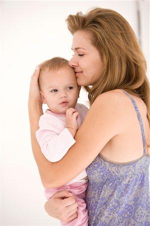 Woman hugging her daughter Stock Photo - Premium Royalty-Free, Code: 6108-05863242