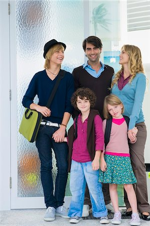 Couple with their children and a nanny at the door of a house Stock Photo - Premium Royalty-Free, Code: 6108-05863401