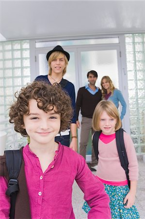 Children with a nanny leaving for school Stock Photo - Premium Royalty-Free, Code: 6108-05863410