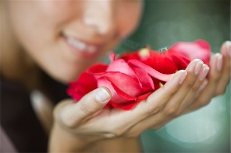 smelly - Woman smelling rose flowers Stock Photo - Premium Royalty-Free, Code: 6108-05863509