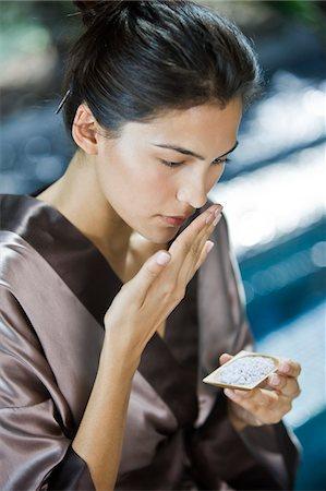 Woman smelling bath salt Stock Photo - Premium Royalty-Free, Code: 6108-05863517