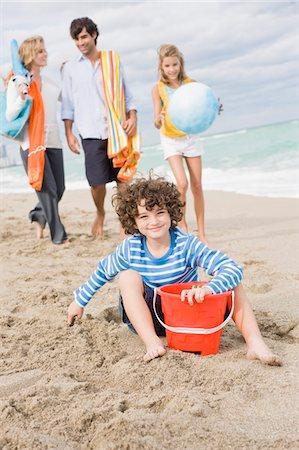 Family enjoying vacations on the beach Stock Photo - Premium Royalty-Free, Code: 6108-05864160