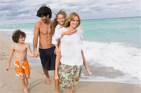 Family enjoying vacations on the beach Stock Photo - Premium Royalty-Free, Code: 6108-05864184