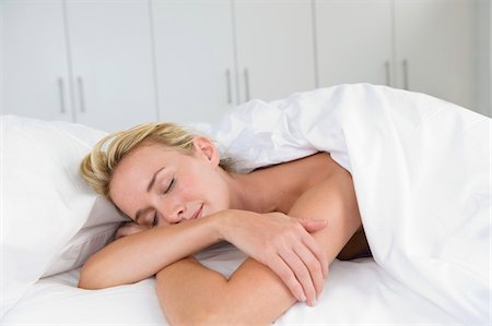 sleeping nude - Close-up of a woman sleeping on the bed Stock Photo - Premium Royalty-Free, Code: 6108-05864390